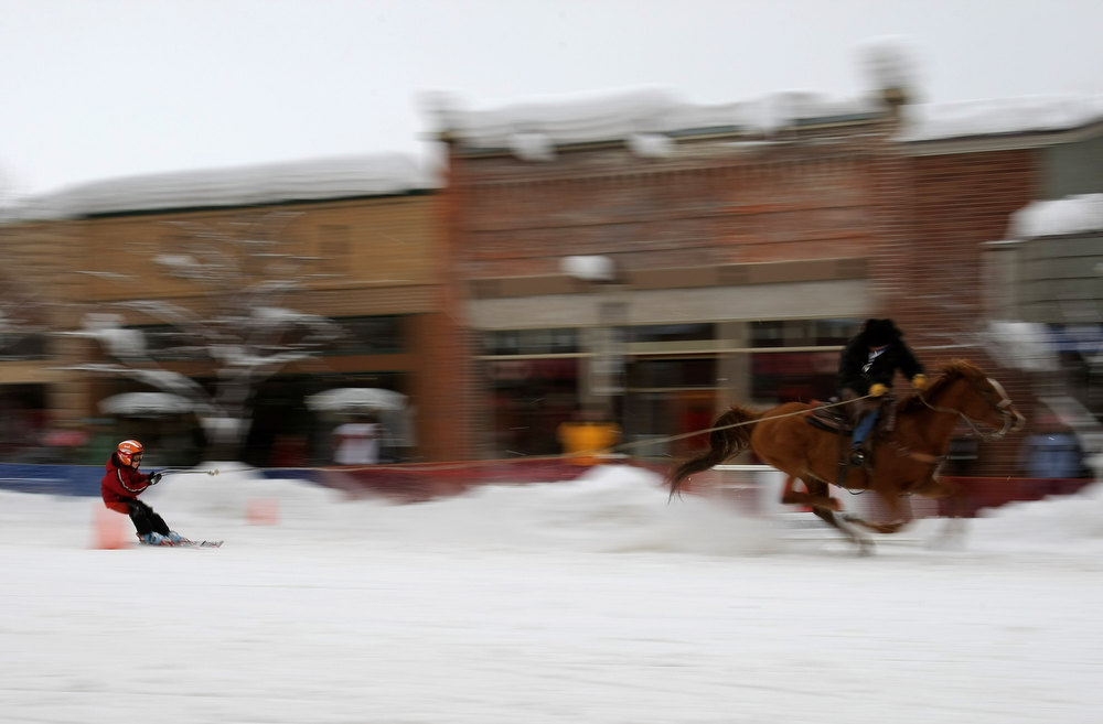 . STEAMBOAT SPRINGS, CO - FEBRUARY 09:  A young skier is pulled through the slalom course by a horseback rider during the Street Events at the 95th Annual Steamboat Springs Winter Carnival on February 9, 2008 in Steamboat Springs, Colorado.  Hosted by the Steamboat Springs Winter Sports Club the winter carnival is an annual competition featuring racing, ski jumping, various snow-related events held on the main street and the Lighted Man. Started in 1914 and held for several days in February in northwest Colorado, the town of Steamboat Springs is taken over by snow lovers, ranchers, cowboys, the young and old who come together to show visitors how winter is celebrated.  (Photo by Doug Pensinger/Getty Images)