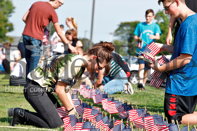 Abby King and Brian Elliot place American Flags at Mars Senior High School to commemorate September 11th victims. Seb Foltz/Butler Eagle