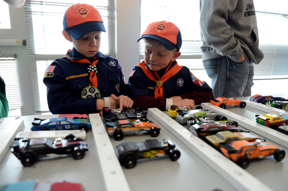 . COMMERCE CITY, CO. - JANUARY 26: Alex Crumrine 6-years-old (L) and Westin Thorne 6-years-old check out the pinewood cars in pit row during the 2013 Pack 414 Pinewood Derby races at Ortho Stuart Middle School January 26, 2013 in Commerce City.  (Photo By John Leyba / The Denver Post)