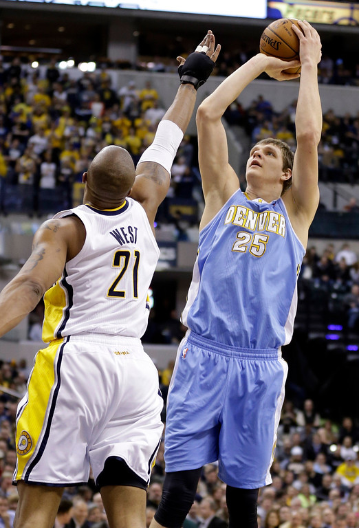 . Denver Nuggets center Timofey Mozgov (25) shoots over Indiana Pacers forward David West in the first half of an NBA basketball game in Indianapolis, Monday, Feb. 10, 2014. (AP Photo/Michael Conroy)