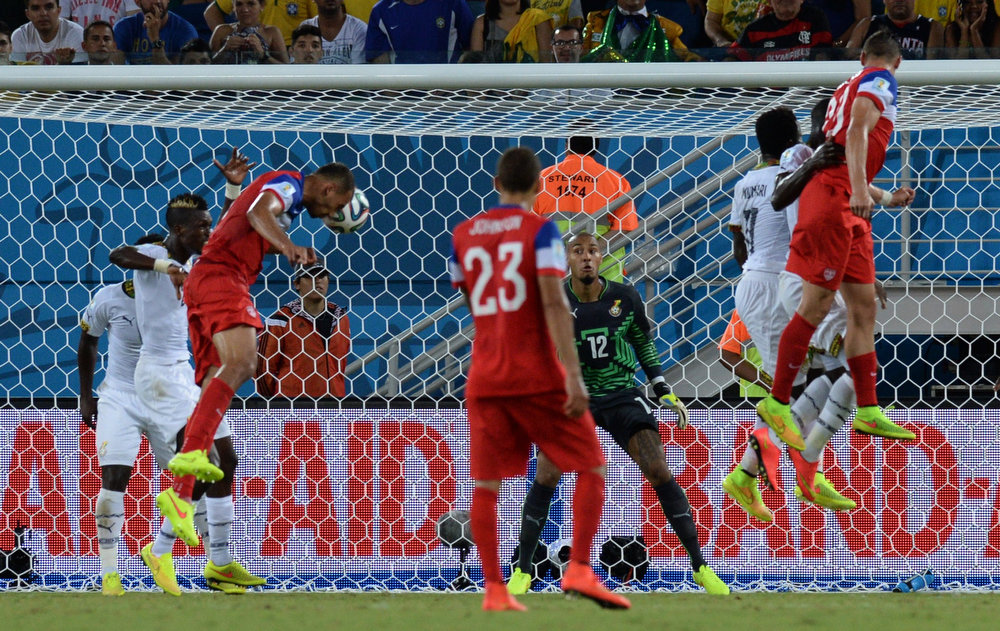 Description of . US defender John Brooks (3L) scores during a Group G football match between Ghana and US at the Dunas Arena in Natal during the 2014 FIFA World Cup on June 16, 2014.  AFP PHOTO / CARL DE SOUZACARL DE SOUZA/AFP/Getty Images