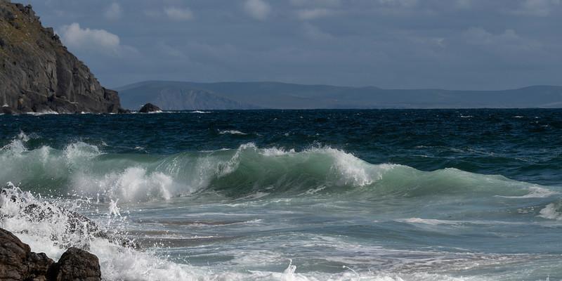 Waves breaking over rocks on the coast, Ballyferriter, County Kerry, Ireland