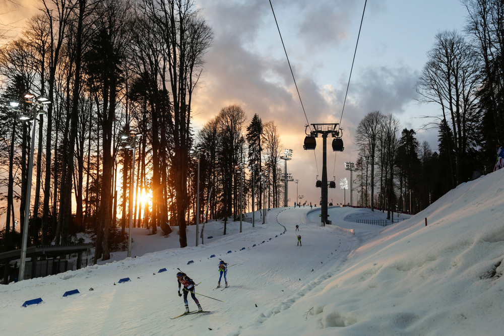 . Athletes ski at sun sets during the women\'s biathlon 4x6k relay at the 2014 Winter Olympics, Friday, Feb. 21, 2014, in Krasnaya Polyana, Russia. (AP Photo/Felipe Dana)