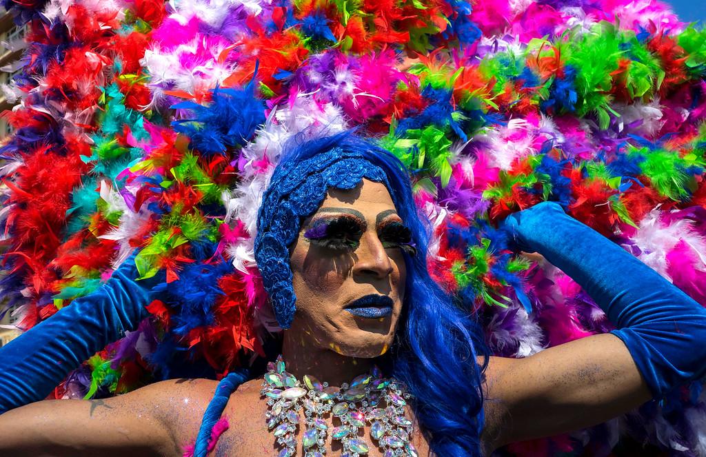 . A member of Cuba\'s LGBT community takes part in a gay pride parade in Havana, Cuba, Saturday, May 14, 2016. (AP Photo/Ramon Espinosa)