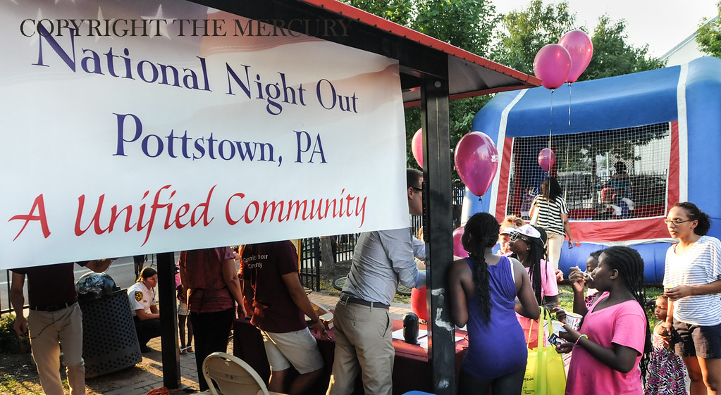 . Victory Christian Life Center and Genesis Housing Inc. teamed up for National Night Out event held at the Chestnut Street Park with a sign stating that Pottstown is a Unified Community. Photo by John Strickler The Mercury