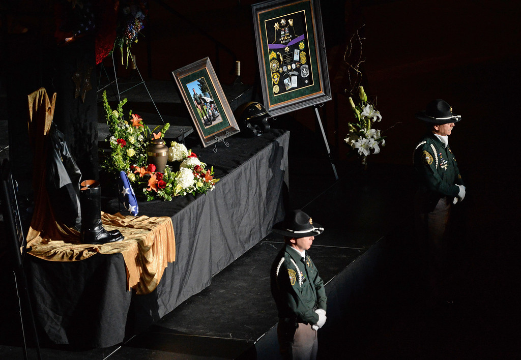 . Members of the Jefferson County Sheriff\'s Department stand in honor at the funeral of Sgt. David Baldwin at the First Bank Events Center in Broomfield, February, 03 2014. Baldwin was on motorcycle patrol riding north on Colorado 93 on Sunday morning when he was hit by a vehicle that crossed the double-yellow line. (Photo by RJ Sangosti/The Denver Post)
