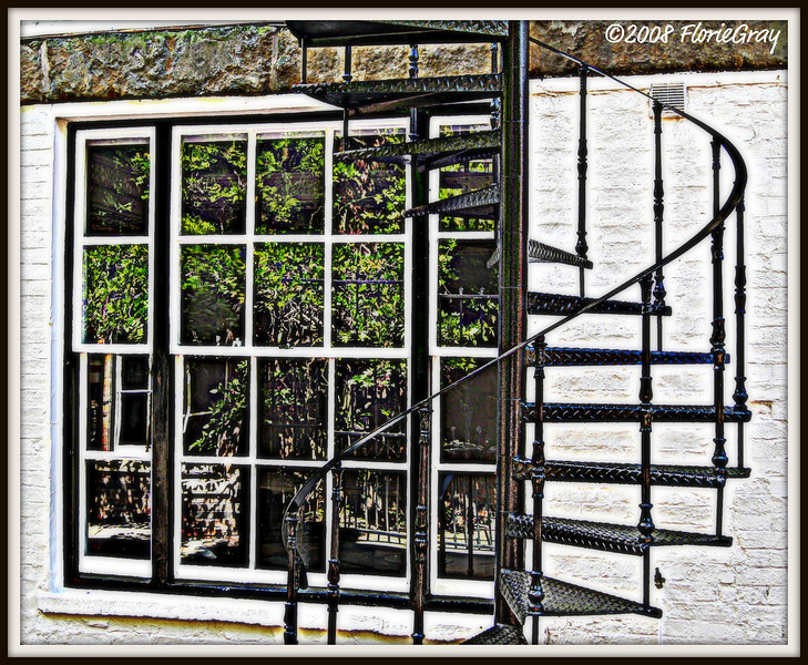 Spiral Staircase and Summer Reflection; Banbury, England     Copyright ©2009 Florence T. Gray. This image is protected under International Copyright laws and may not be downloaded, reproduced, copied, transmitted or manipulated without written permission.