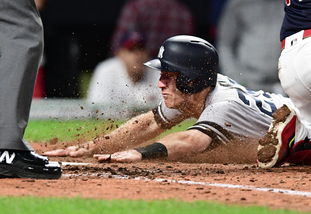 . New York Yankees\' Todd Frazier scores during the ninth inning against the Cleveland Indians in Game 5 of a baseball American League Division Series, Wednesday, Oct. 11, 2017, in Cleveland. (AP Photo/David Dermer)