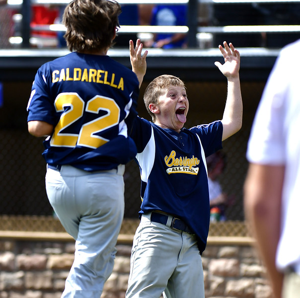 8/10/2019 Mike Orazzi | Staff Rhode Island's Barrington Little League pitcher Owen Pfeffer (13) leads the celebration after his complete game 80 pitch win on Saturday over New Hampshire's Goffstown Junior Baseball Little League at Breen Field in Bristol, Conn., during the New England Regional and advancing to the Little League World Series in Williamsport PA.