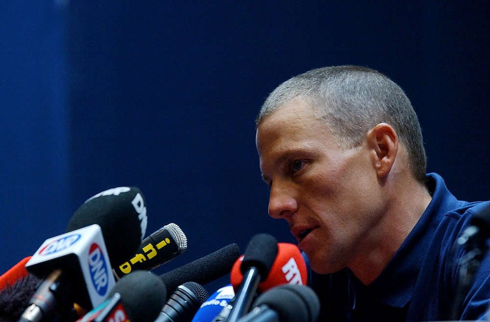 Description of . Three-time Tour de France winner Lance Armstrong of Austin, Texas, ponders a question during a press conference after undergoing medical examinations ahead of the Tour de France cycling race in Luxembourg, Thursday, July 4, 2002. The 21-stage Tour will start in Luxembourg on Saturday July 6, 2002, to end in Paris on July 28. (AP Photo/Christophe Ena)