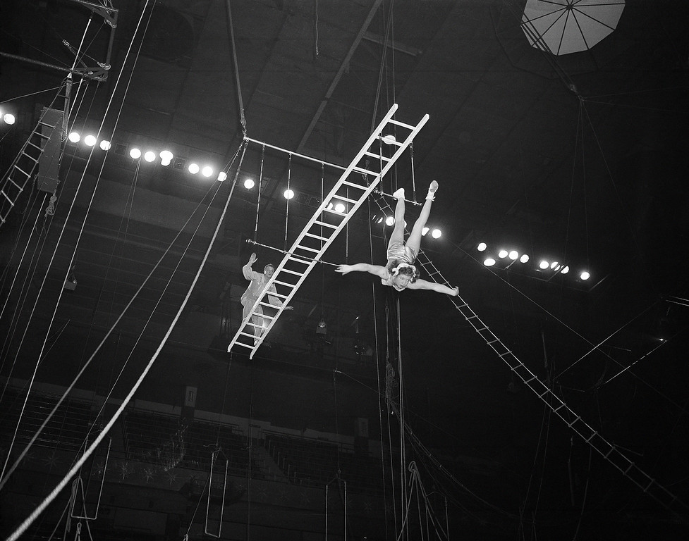 . The Rixos on their balanced ladder on a trapeze rehearse their act for Ringling Bros. and Barnum and Bailey Circus at Madison Square Garden, New York, March 30, 1954.(AP Photo/Matty Zimmerman)