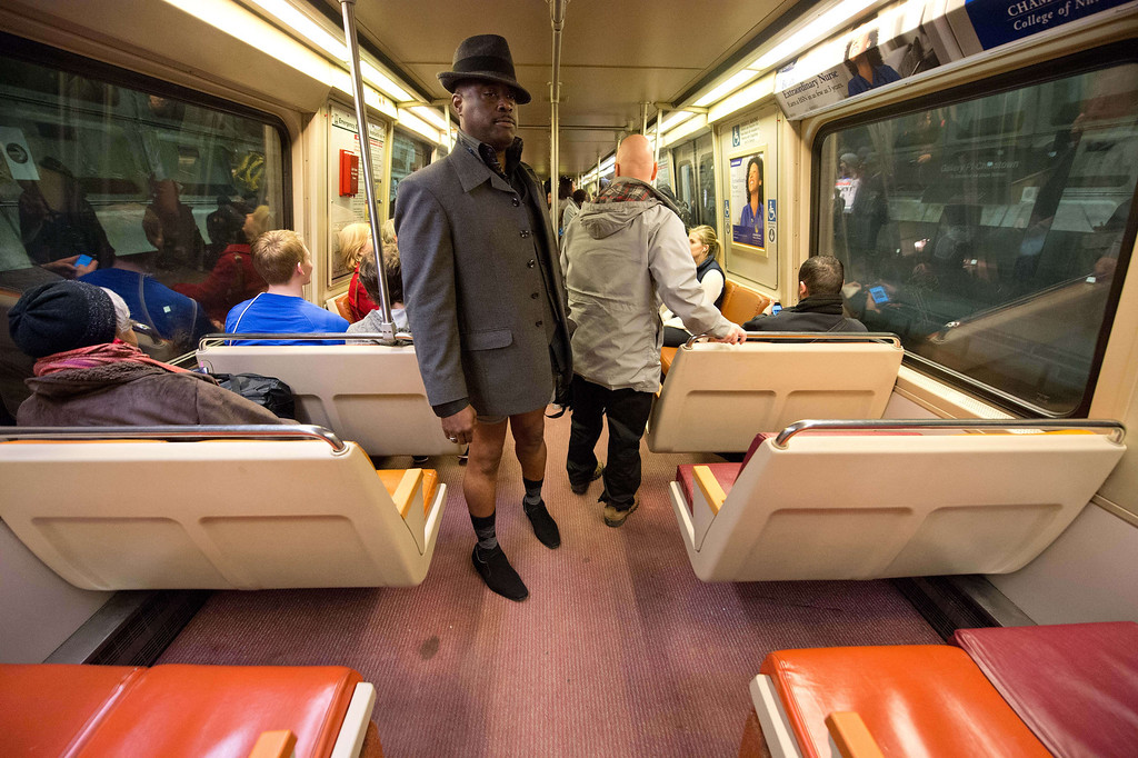 """. A man taking part in the \""""No Pants Subway Ride\"""" rides a metro train in Washington on January 12, 2014. \""""No Pants Subway Ride\"""" is an annual event in which transit passengers ride trains without wearing pants in January. The event is observed in dozens of cities worldwide.  NICHOLAS KAMM/AFP/Getty Images"""