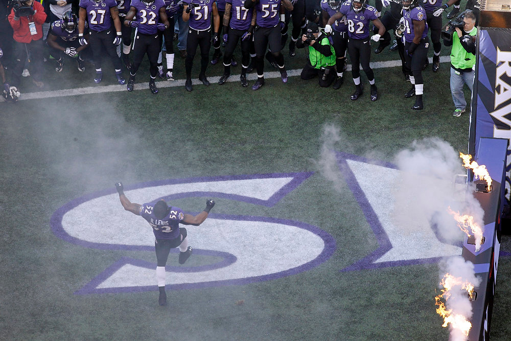 Description of . Baltimore Ravens inside linebacker Ray Lewis (52) celebrates as he is introduced before an NFL wild card playoff football game against the Indianapolis Colts Sunday, Jan. 6, 2013, in Baltimore. (AP Photo/Patrick Semansky)