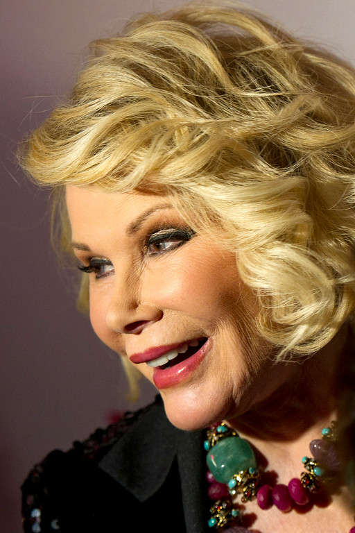 """. Joan Rivers attends a screening of the season two premiere of WE tv\'s \""""Joan & Melissa: Joan Knows Best?\"""" in New York, Thursday, Jan. 19, 2012. (AP Photo/Charles Sykes)"""