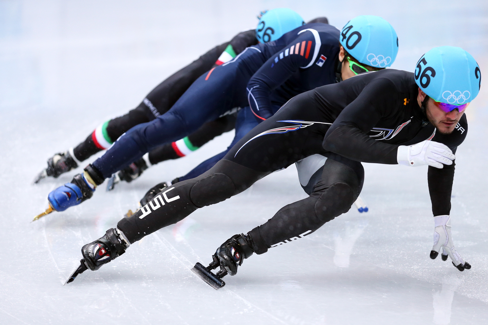 . Eduardo Alvarez of the United States leads the pack in the Short Track Men\'s 500m Heat at Iceberg Skating Palace on day 11 of the 2014 Sochi Winter Olympics on February 18, 2014 in Sochi, Russia.  (Photo by Matthew Stockman/Getty Images)