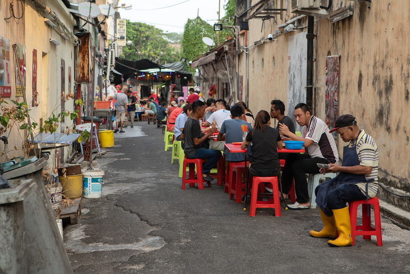 Locals eat at an informal restaurant on a side street in UNESCO World Heritage City Malacca, Malaysia. Malacca is renowned for its complex regional cuisine which is a combination of Peranakan (a chinese-malay style of cooking) and local flare of Dutch, Portuguese, Malay, Indian, and Chinese iinspired food.