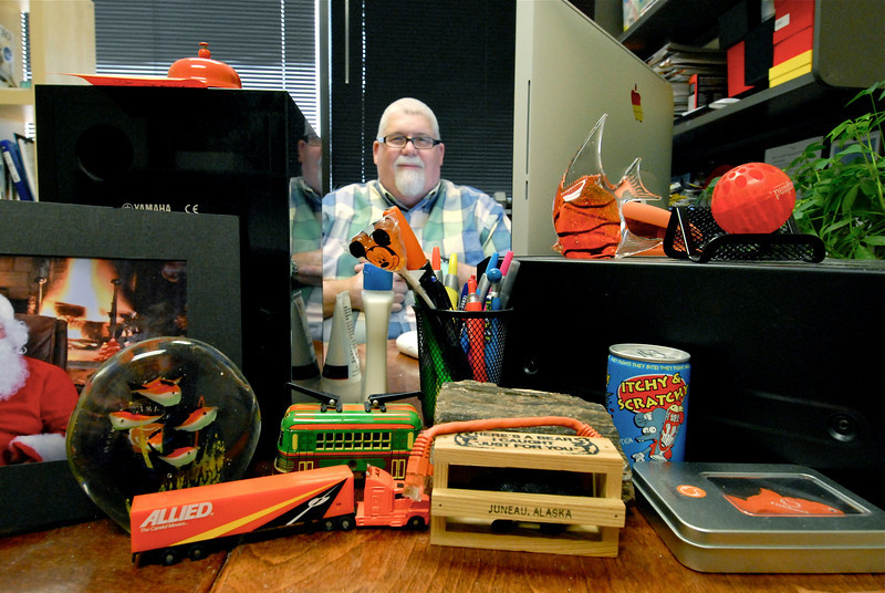 2011/4/13 – I popped on my fixed 50MM portrait lens this morning at work for fun. I went into Rick's office to shoot all the stuff on his desk. It looks like he is buried behind all the stuff, but I shot it from waist high to emphasize the items in the foreground. It isn't as crazy as it looks, but everyone loves to play with the things on his desk.