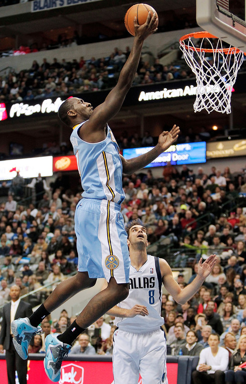 . Denver Nuggets forward J.J. Hickson (7) goes up for a layup as Dallas Mavericks Jose Calderon (8) watches during the first half of an NBA basketball game Monday, Nov. 25, 2013, in Dallas. (AP Photo/Brandon Wade)