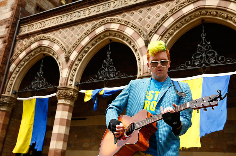 . Tim Sorbanelli, 21, a Berklee College of Music student, plays his guitar near the finish line of the Boston Marathon prior to the flag raising ceremony commemorating the one-year anniversary of the Boston Marathon bombings on Boylston Street near the finish line on April 15, 2014 in Boston, Massachusetts.  (Photo by Jared Wickerham/Getty Images)