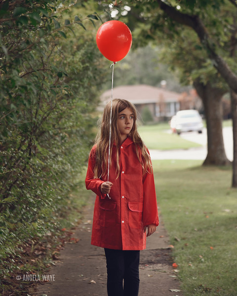 Lonely Child Holding Red Balloon Outside