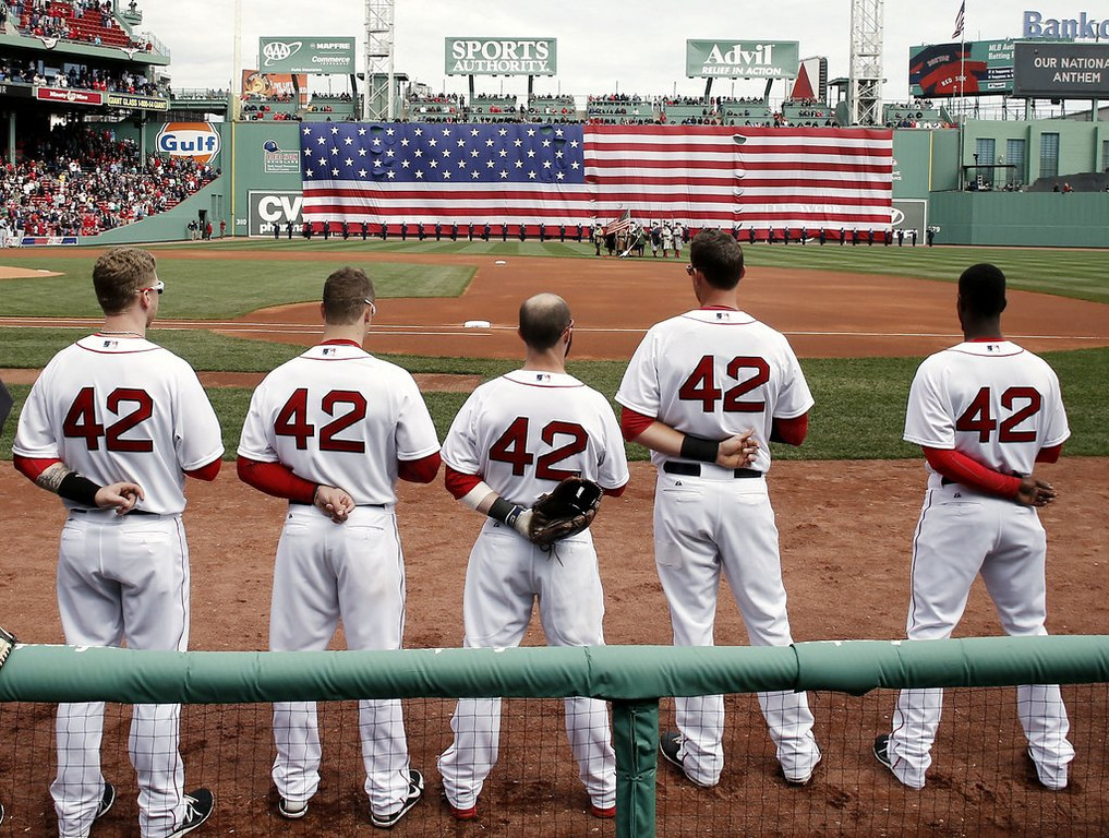 ". <p><b> All major league baseball players wore the number 42 during Wednesday�s games, paying tribute to � </b> <p> A. Jackie Robinson <p> B. Mariano Rivera  <p> C. The number of pitchers who have had Tommy John surgery this month <p><b><a href=\'http://www.usatoday.com/story/sports/mlb/2014/04/14/jackie-robinson-day-mlb-hank-aaron-racism-still-exists/7723045/\' target=""_blank\"">HUH?</a></b> <p>    (AP Photo/Winslow Townson)"