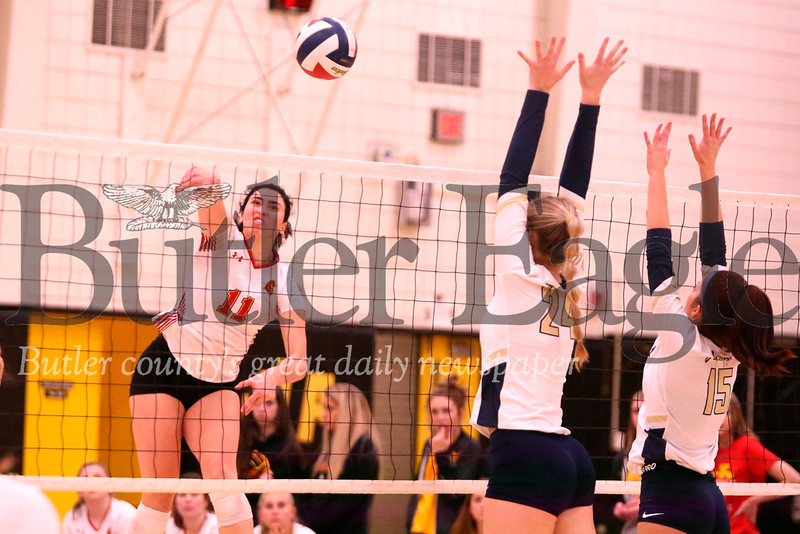 North Catholic's Dominique Felix (11) goes up for a spike during the Trojans' 2-0 playoff win over Freeport Tuesday night at North Allegheny. Seb Foltz/Butler Eagle