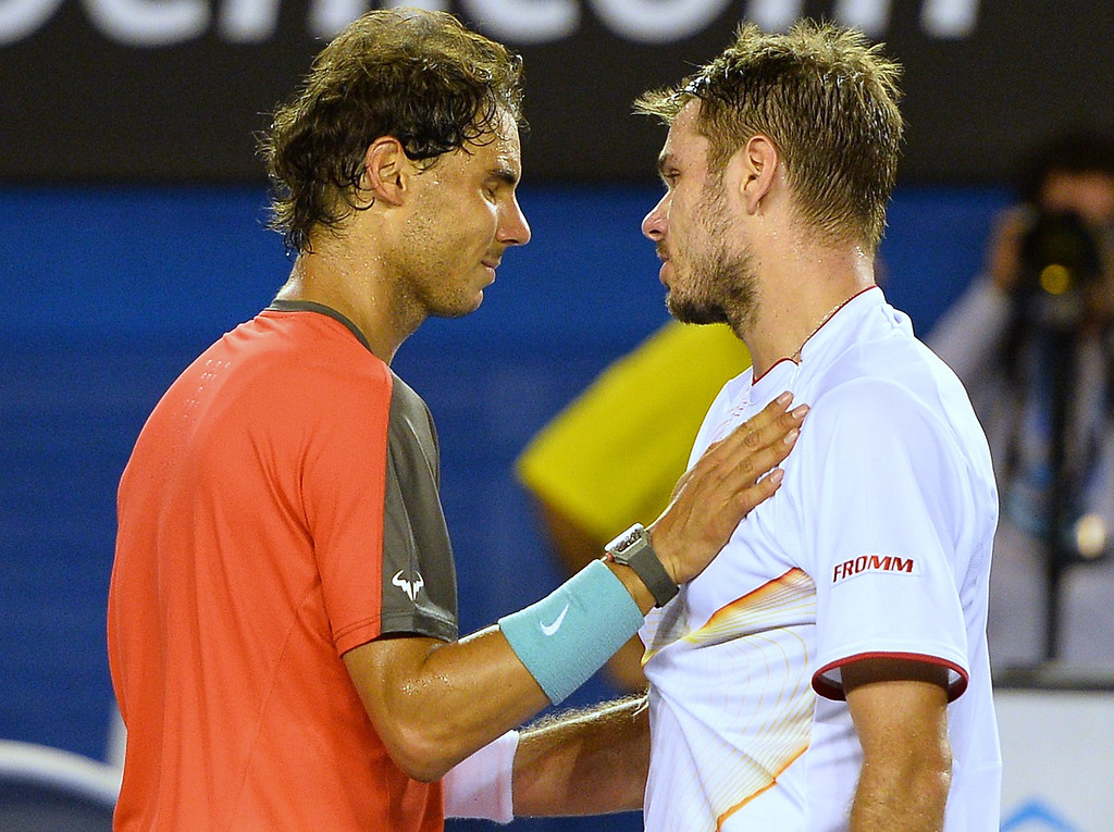 . Switzerland\'s Stanislas Wawrinka (R) speaks with Spain\'s Rafael Nadal after his victory during the men\'s singles final on day 14 of the 2014 Australian Open tennis tournament in Melbourne on January 26, 2014.   SAEED KHAN/AFP/Getty Images