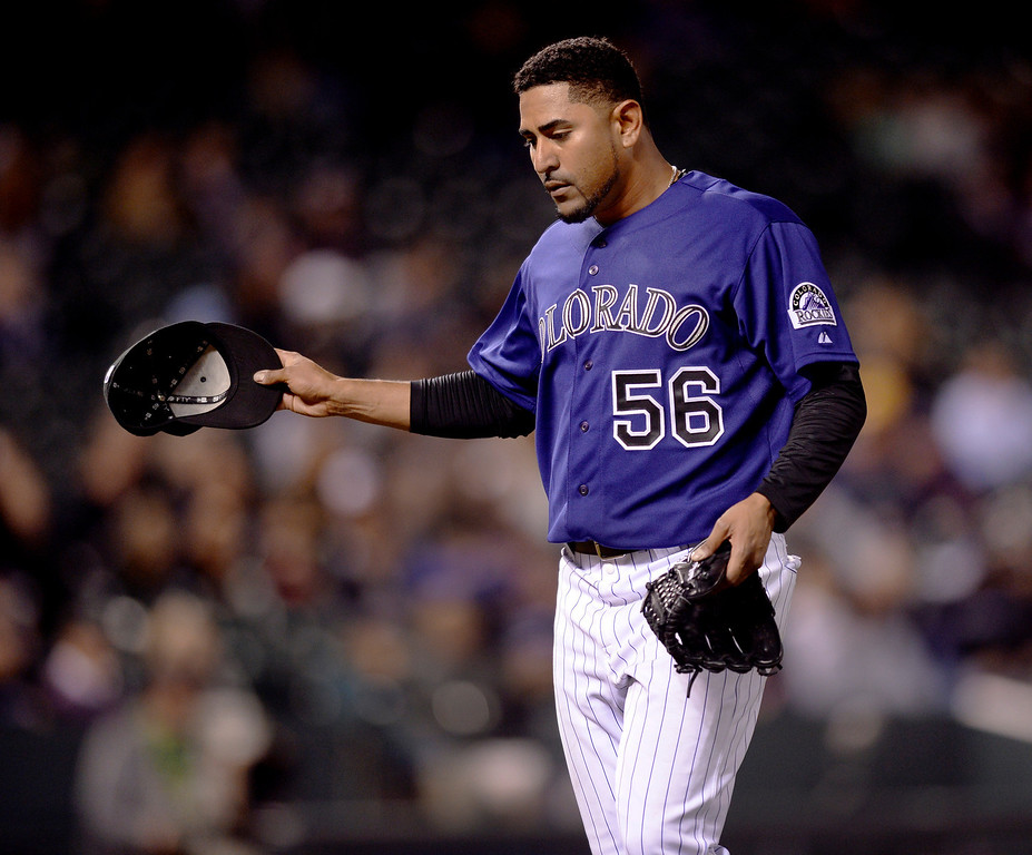 . Colorado starting pitcher Franklin Morales gestured as he walked to the dugout after being pulled from the game in the seventh inning. The Chicago White Sox clobbered the Colorado Rockies 15-3 Tuesday night, April 8, 2014 at Coors Field in Denver.  (Photo by Karl Gehring/The Denver Post)