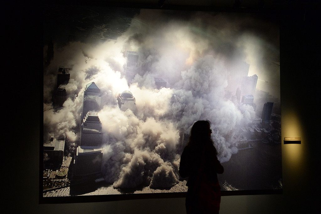 . A photograph of one of the World Trade Center towers collapsing after the September 11, 2001 attack, seen during a press preview of the National September 11 Memorial Museum at the World Trade Center site May 14, 2014 in New York. AFP PHOTO/StanHONDA/AFP/Getty Images