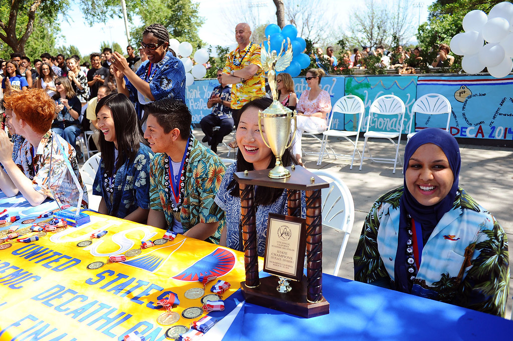 . Members of El Camino Real Charter High School\'s Academic Decathlon team pose for photos during a rally in honor of their seventh national title last week in Honolulu, Hawaii May 1, 2014.(Andy Holzman/Los Angeles Daily News)