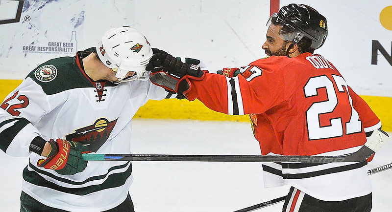. Minnesota Wild right wing Nino Niederreiter, left, and Chicago Blackhawks defenseman Johnny Oduya get in a tussle after the game. (Pioneer Press: Ben Garvin)