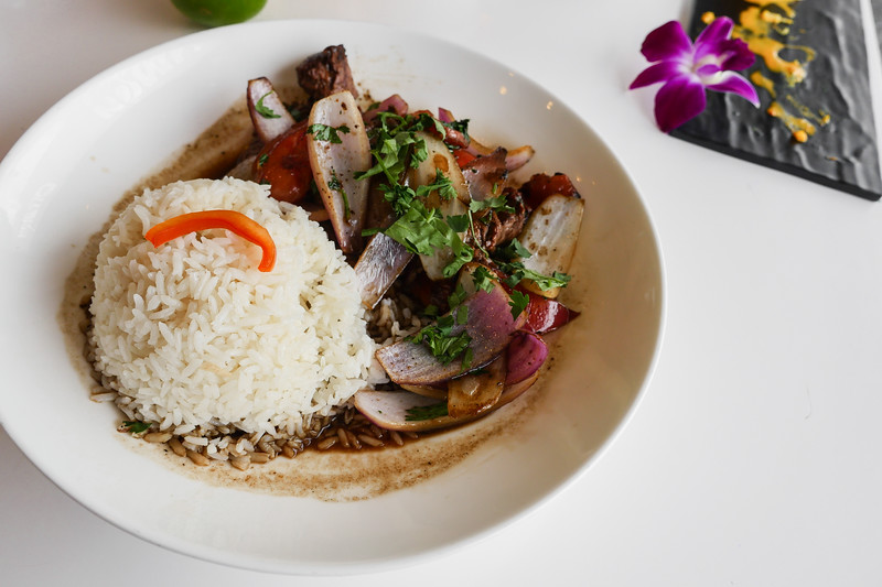 Lomo Saltado - onions, tomatoes, certified Angus beef