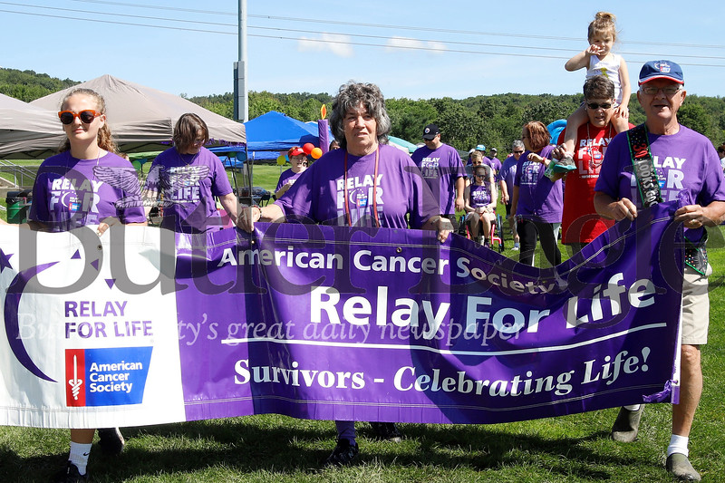Clad in purple, cancer survivors walked the first ceremonial lap of the Relay For Life event Saturday at North Boundary Park in Cranberry, before being joined by friends and loved ones for the laps to follow. Seb Foltz/Butler Eagle