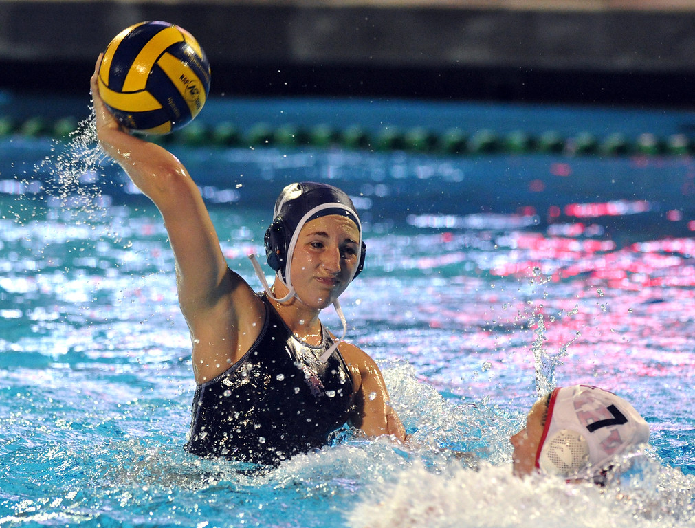 . Crescenta Valley\'s Katie Benson (#17) makes a goal over Redlands East Valley\'s Allison Wieseler (#7) in the Southern Section Div. V semifinals girls game water polo at Whittier College\'s Lillian Slade Aquatics Center on Wednesday February 20, 2013. Crescenta Valley beat Redlands East Valley 14-4. (Staff photo by Keith Durflinger)