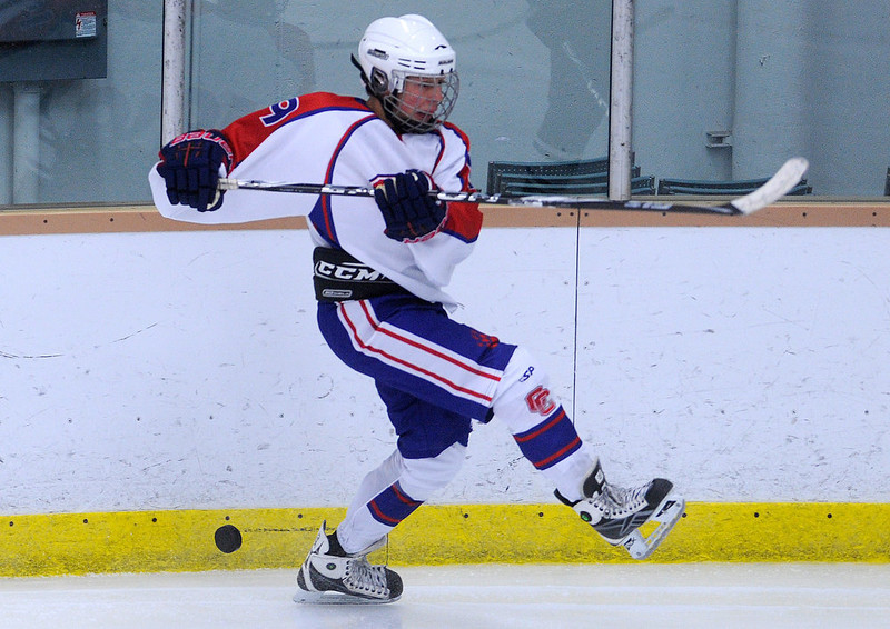. Cherry Creek\'s Jake Fogleman lets the puck slide past him against Cheyenne Mountain in 5A High School Hockey action at Family Sports Center in Englewood, CO Saturday December 8, 2012. (Photo by Evan Semon, Special to The Denver Post)