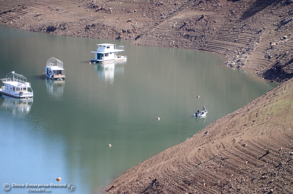 . A couple of fishermen are seen along the shoreline at Lake Oroville near the Lime Saddle Marina Monday March 5, 2018. (Bill Husa -- Enterprise-Record)
