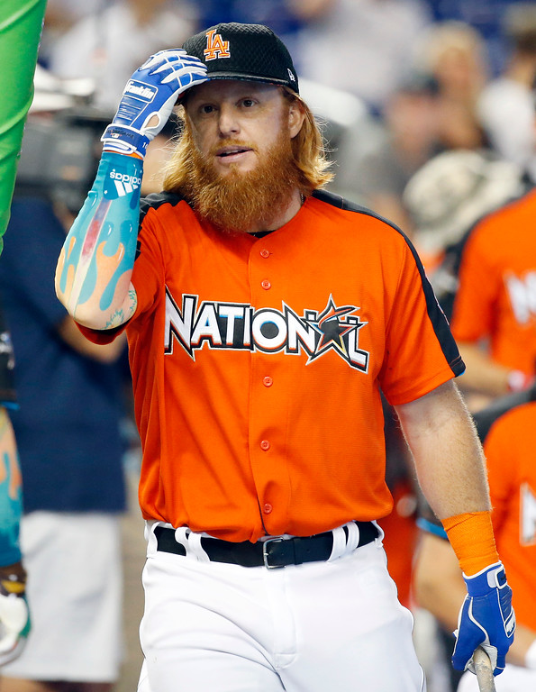. Los Angeles Dodgers \' Justin Turner heads for batting practice before the MLB baseball All-Star Home Run Derby, Monday, July 10, 2017, in Miami. (AP Photo/Wilfredo Lee)