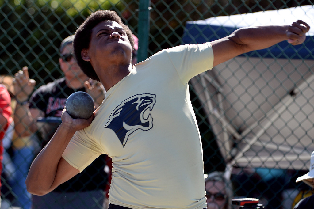 . Peninsula\'s Mitchel Charles competes in the shot put during the CIF-SS Masters Track and Field meet at Falcon Field on the campus of Cerritos College in Norwalk, Calif., on Friday, May 30, 2014.   (Keith Birmingham/Pasadena Star-News)