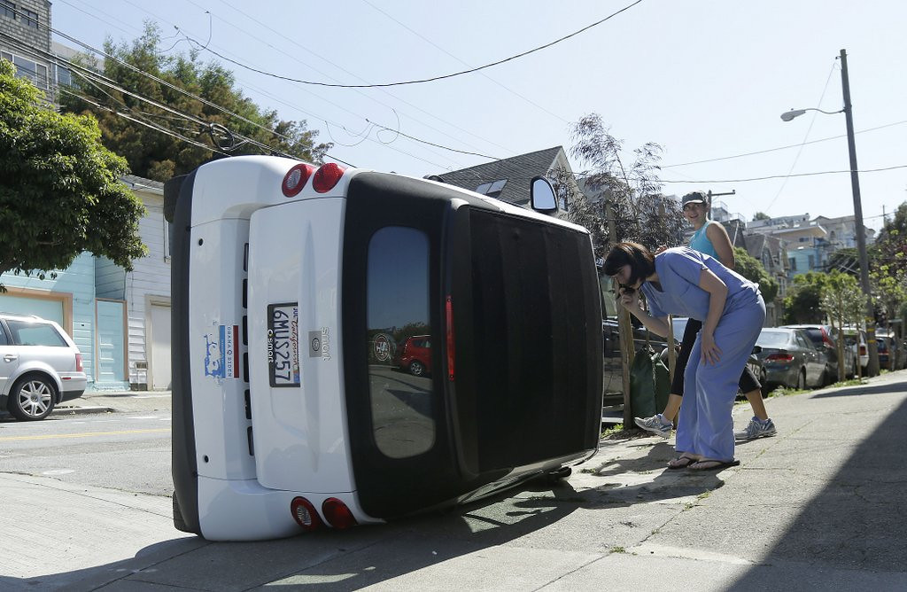 ". <p><b> Some San Francisco residents were dismayed to see this week that their energy-efficient Smart cars had been flipped by � </b> <p> A. Vandals <p> B. Protesters <p> C. 12 mph winds <p><b><a href=\'http://www.nbcbayarea.com/news/local/Suspects-Flip-Over-Smart-Cars-in-San-Francisco-254177981.html\' target=""_blank\"">HUH?</a></b> <p>   (AP Photo/Jeff Chiu)"