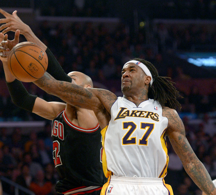 . The Los Angeles Lakers\' Jordan Hill tangles up with Chicago Bulls\' Taj Gibson in the NBA basketball game at Staples Center in Los Angeles, CA. on Sunday, February 9, 2014. (Photo by Sean Hiller/ Daily Breeze).