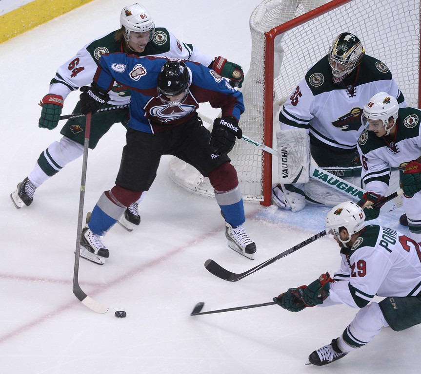 . Matt Duchene (9) of the Colorado Avalanche movies with the puck surrounded by Wild defenders during the third period of action.   (Photo by Karl Gehring/The Denver Post)