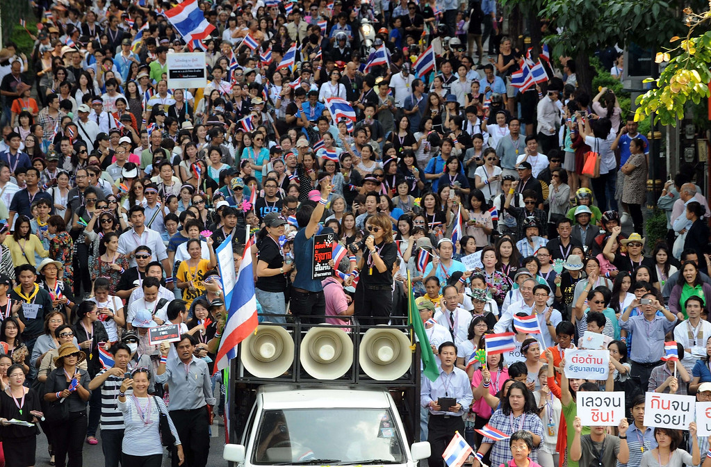 . Anti-government protestors wave flags during a protest march in Bangkok on November 29, 2013.   AFP PHOTO/Indranil MUKHERJEE/AFP/Getty Images