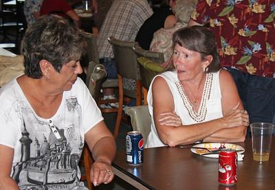 Betty (Horse) Cogdill and Charlene Boggs discuss the relative merits of Coke vs. Pepsi.