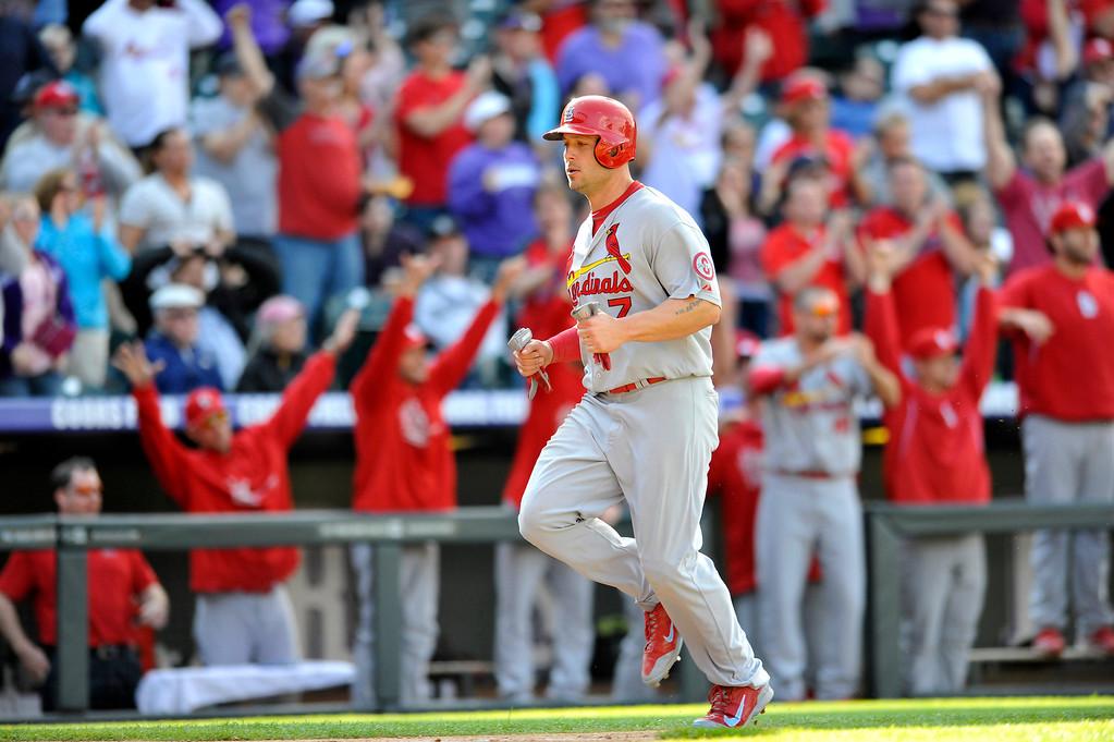 . St. Louis Cardinals\' Matt Holliday runs home to score on a David Freese RBI-double hit off Colorado Rockies relief pitcher Chad Bettis during the eighth inning of a baseball game on Thursday, Sept. 19, 2013, in Denver. (AP Photo/Jack Dempsey)