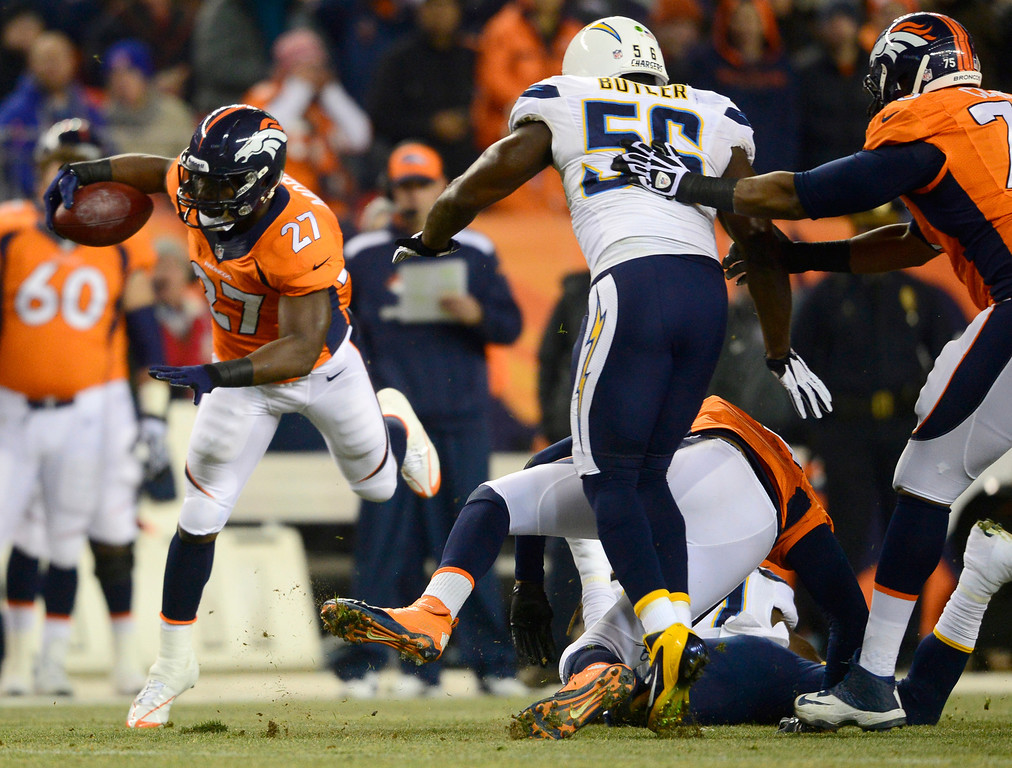 . Denver Broncos running back Knowshon Moreno (27) running on the first drive of the game. The Denver Broncos vs. the San Diego Chargers at Sports Authority Field at Mile High in Denver on December 12, 2013. (Photo by AAron Ontiveroz/The Denver Post)