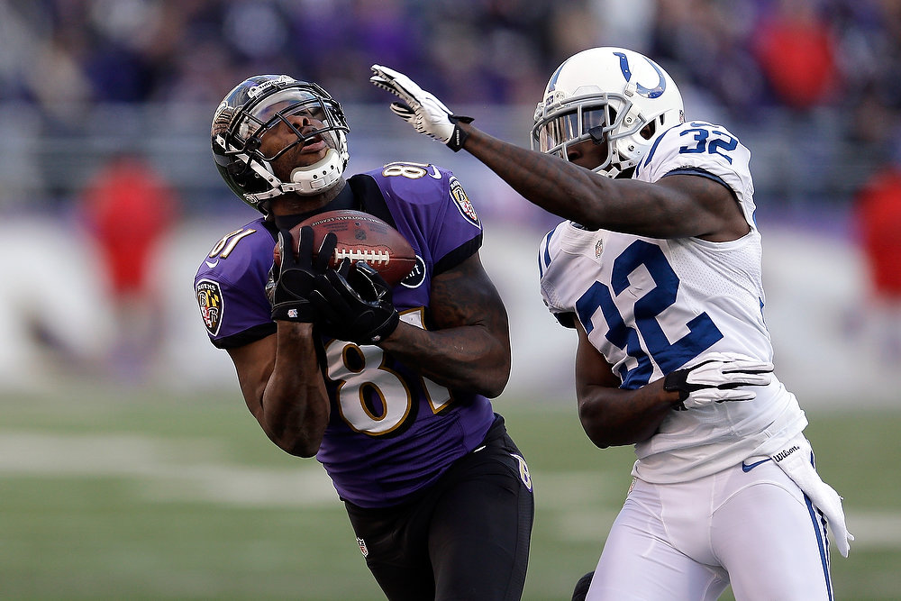 Description of . Anquan Boldin #81 of the Baltimore Ravens makes a reception in the third quarter against Cassius Vaughn #32 of the Indianapolis Colts during the AFC Wild Card Playoff Game at M&T Bank Stadium on January 6, 2013 in Baltimore, Maryland.  (Photo by Rob Carr/Getty Images)