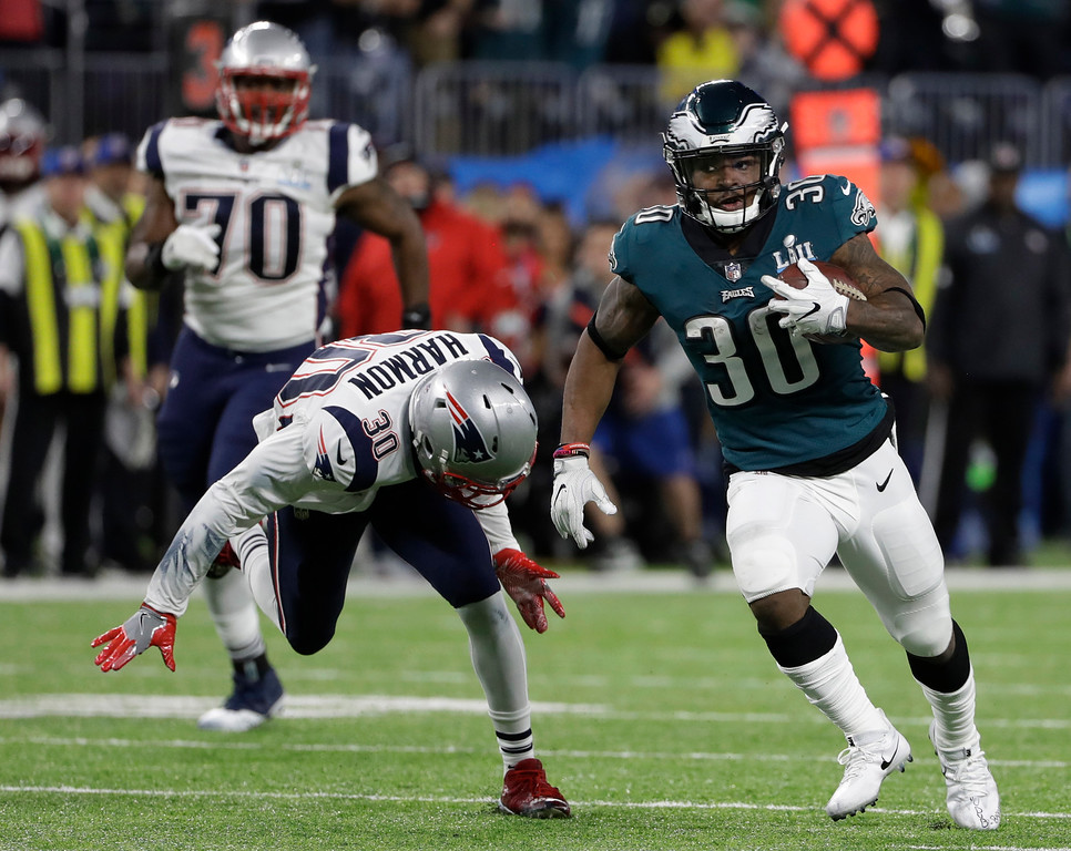 . Philadelphia Eagles running back Corey Clement (30) runs ahead of New England Patriots strong safety Duron Harmon (30), during the first half of the NFL Super Bowl 52 football game against the New England Patriots, Sunday, Feb. 4, 2018, in Minneapolis. (AP Photo/Chris O\'Meara)