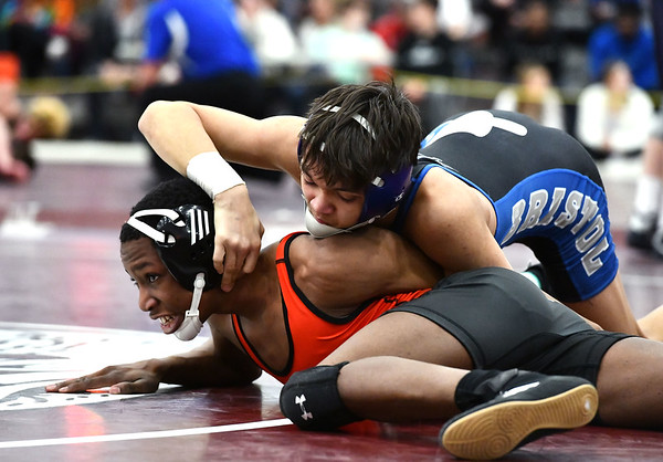2/22/2020 Mike Orazzi | StaffrBristol Eastern's Anthony Silva and E.O. Smith's Tutu Hansen in a 113 match during the Class L State Wrestling Tournament held at Bristol Central High School on Saturday.