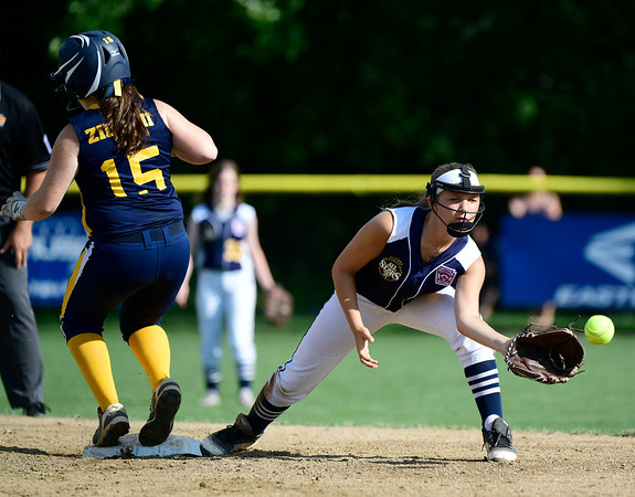 7/24/2019 Mike Orazzi | Staff New Jersey's Katie Ziliani (15) and Connecticut's Talia Salanto (4) during Wednesday's Little League softball game at Breen Field in Bristol.