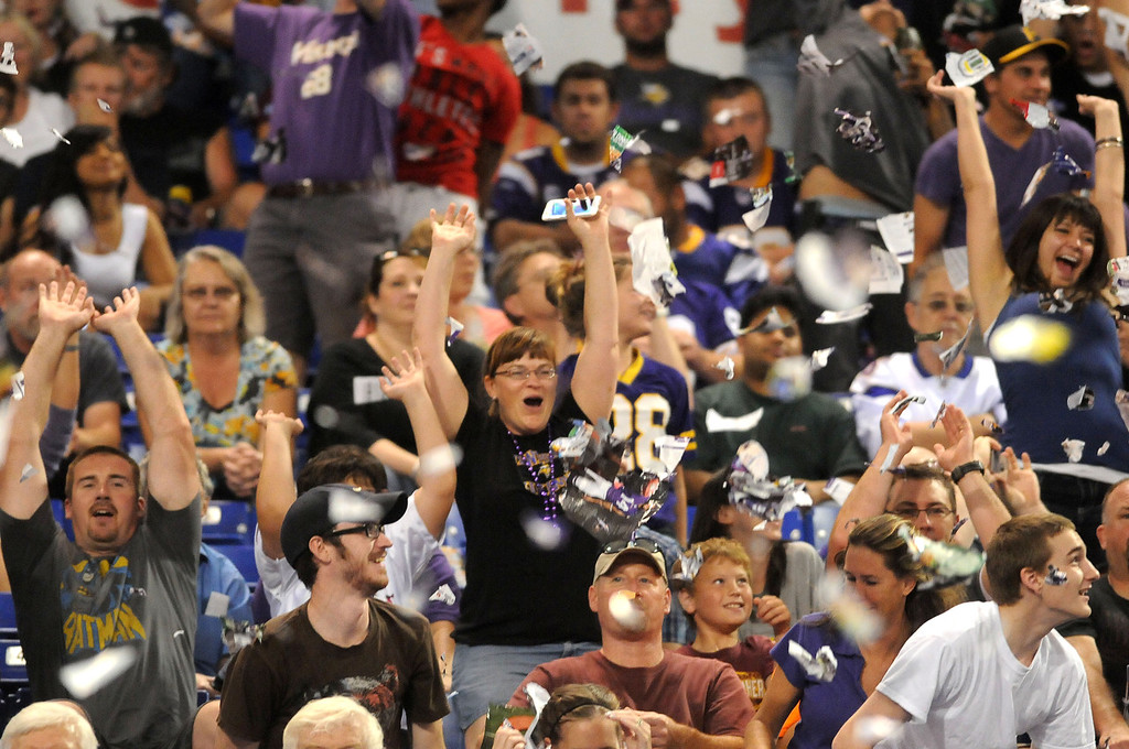 . Fans throw ripped programs into the air during the the wave in the second half of the Vikings\' 24-23 win over the Titans.  (Pioneer Press: Sherri LaRose-Chiglo)
